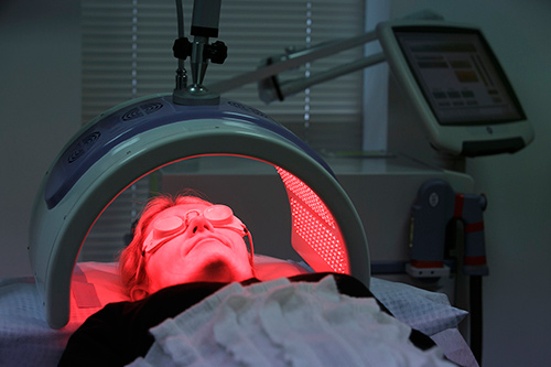 PDT treatment showing patient under red activating light